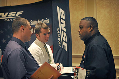 John Wesley, BNSF military recruiter, right, speaks with transitioning military personnel at the USO/Hire Heroes USA Career Day on Thursday, July 24, 2014 in Colorado Springs, Colo.